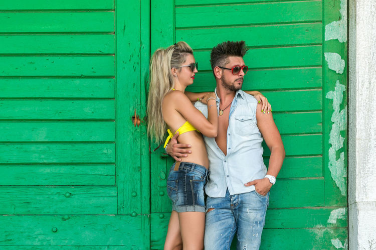 Two People Togetherness Love Young Adult Couple - Relationship Three Quarter Length Standing Young Men Young Women Casual Clothing Positive Emotion Women Men Young Couple Emotion Heterosexual Couple Bonding Adult Romance Day Hair Outdoors Shorts