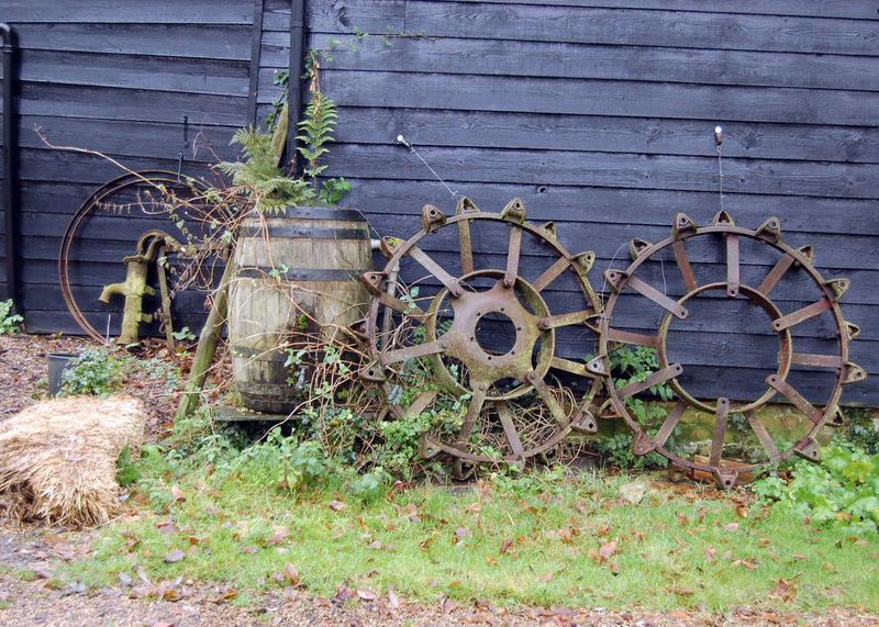 Abandoned Bad Condition Day Deterioration Farm Farm Yard Junk Land Vehicle Metal Mode Of Transport No People Obsolete Old Outdoors Plant Run-down Rusty Transportation Wall - Building Feature Weathered Wheel