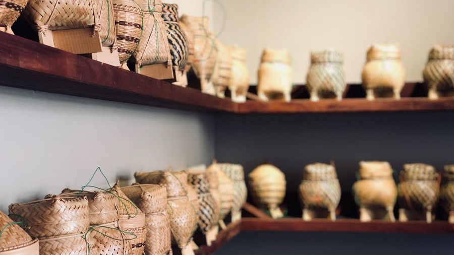 Close-Up Of Baskets On Shelf In Store