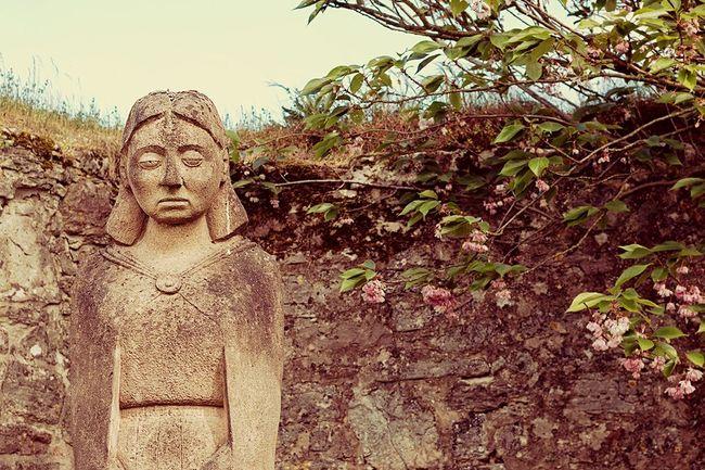 Stony face Statue Modern Art Stone Wall Blooming Tree Abbey Cistercian Garden Brunswick Braunschweig