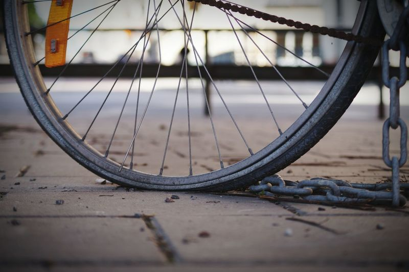 Close-Up Of Bicycle Tire On Street