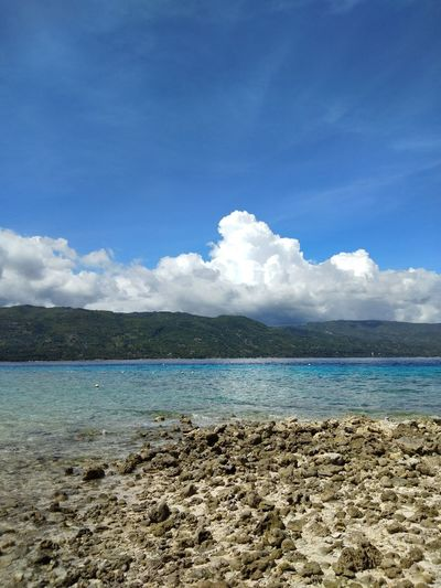 Water Cloud - Sky Sky Beach Sea Blue Vacations Day Nature Outdoors Travel Destinations Sand No People