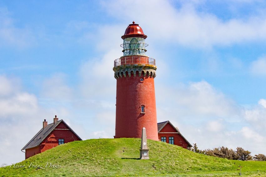 Cloud - Sky Sky Architecture Built Structure Tower Day Building Exterior Grass Low Angle View No People Outdoors Lighthouse Nature