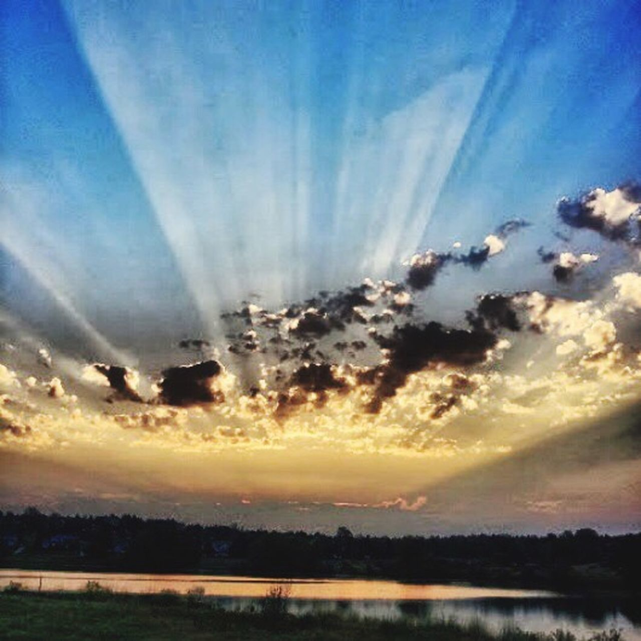 sunset, dramatic sky, cloud - sky, sky, scenics, sunbeam, nature, beauty in nature, silhouette, cloudscape, tranquil scene, atmospheric mood, bright, heaven, multi colored, backgrounds, outdoors, sunlight, no people, dusk, sun, awe, tranquility, sky only, landscape, saturated color, horizon over water, water, day