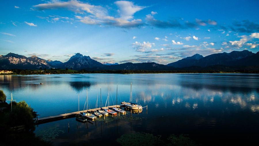Boat in lake against blue sky