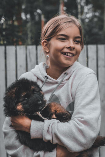 Portrait of a smiling young woman with dog