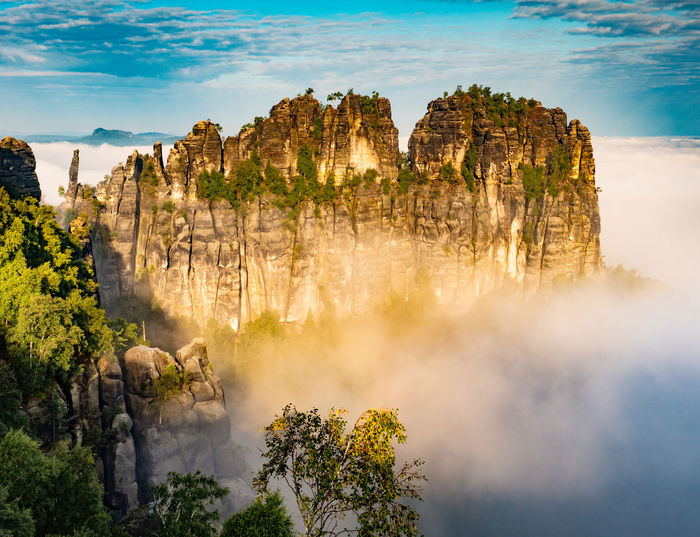 Schrammsteine rock formations stand in an area known as saxon switzerland, germany, along elbe river
