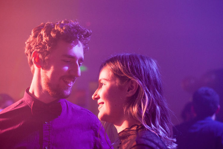 Smiling couple in nightclub