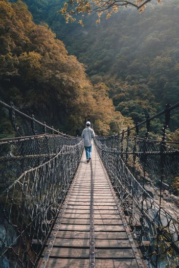 Warm Horizon Travel Destinations Wanderlust Taiwan Go Higher Real People Full Length Leisure Activity Railing One Person The Way Forward Bridge Direction Mountain Connection Beauty In Nature Bridge - Man Made Structure Footbridge Walking Go Higher Focus On The Story