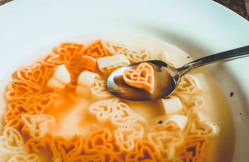 Close-up of heart shape pasta soup in plate