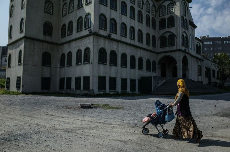 Woman Pushing Stroller On Road