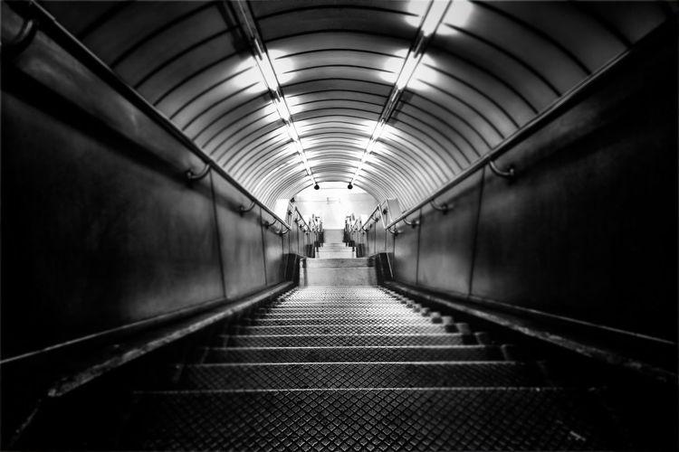 Man walking in illuminated tunnel