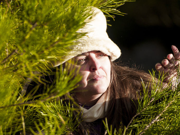 Close-Up Of Woman By Branch