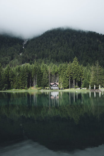 If you live an ordinary life, all you'll have is ordinary stories. My hope is that our lives will end up being anything but ordinary. Throwing back to one crazy escape to Italy this summer. Architecture Beauty In Nature Day Forest Green Color Growth House Lake Landscape Landscape_photography Nature No People Non-urban Scene Outdoors Plant Reflection Scenics - Nature Sky Tranquil Scene Tranquility Tree Water Waterfront