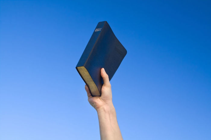 Hand Sharing the Holy Bible Christian Christianity Disciple Faith Hands Mission Spirituality Belief Bible Concept Evangelist Good News Gospel Great Commission Guidance Leadership Preaching Religion Scripture Scriptures Sermon Sharing  Teacher