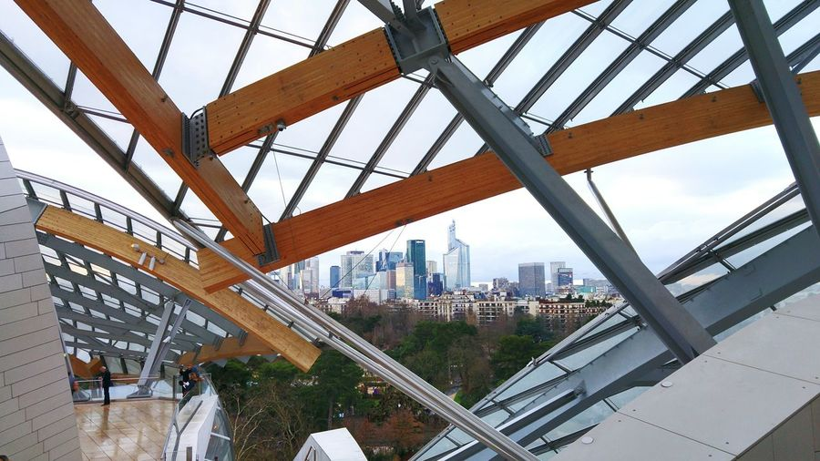 view of La Défense from Louis Vuitton's Foundation ARCHITECT Frank Gehry Frank Gehry Building Louis Vuitton Foundation Paris France Louis Vuitton Foundation La Défense La Defense Paris Architecture City Modern Built Structure Skyscraper Bridge - Man Made Structure Sky Day Indoors  Cityscape Urban Skyline No People
