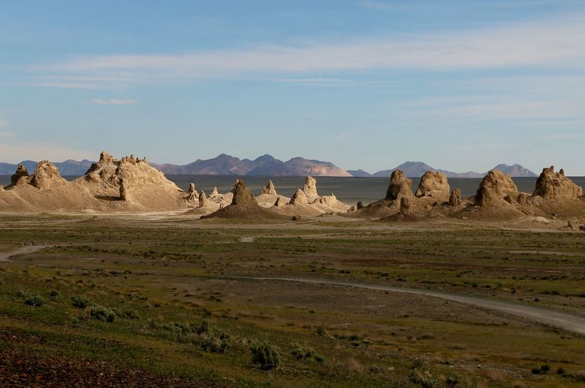 Underwater formations in dried up lake Desert Pinnacles Rock Formations Arid Climate Beauty In Nature Day Dried Up Lake Geology Landscape Mountain Mountains Nature No People Outdoors Physical Geography Scenics Sky Sunlight And Shadow Tranquil Scene Tranquility Trona Pinnacles