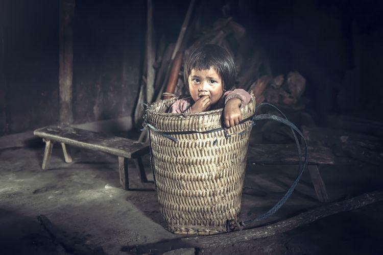 Portrait of girl in basket