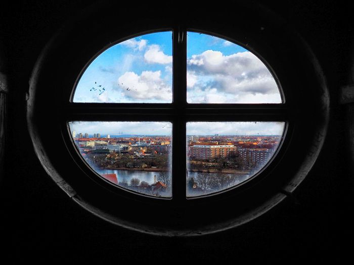View of cityscape seen through window