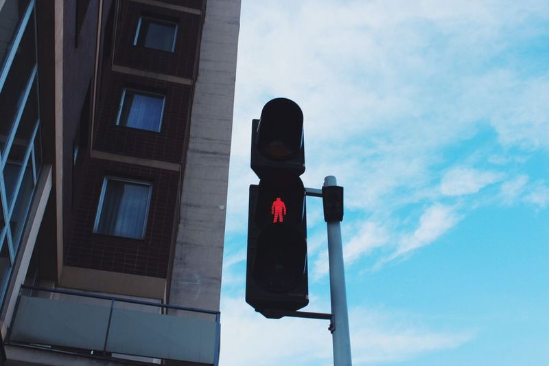 EyeEm Selects Low Angle View Stoplight Sky Day Road Sign Architecture Traffic Signal Outdoors No People Red Light Guidance Building Exterior Cloud - Sky Built Structure Blue City EyeEm Best Shots - Landscape EyeEm Best Shots INDONESIA EyeEmNewHere EyeEmBestPics Sommergefühle Austria Vienna