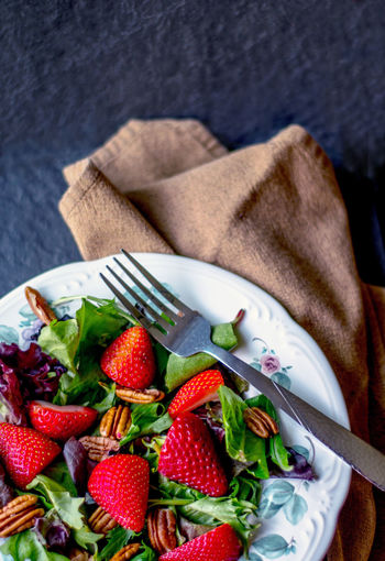 delicious pecan and strawberry salad with mixed greens Good Choices Salad Close-up Diet Food Eating Utensil Farm Grown Food Fork Freshness Fruit Healthy Eating Healthy Lifestyle Indoors  Kitchen Utensil Linen Napkin Mixed Greens Ready-to-eat Red Ripe Space For Text Still Life Strawberries Table Vegan Wellbeing The Still Life Photographer - 2018 EyeEm Awards