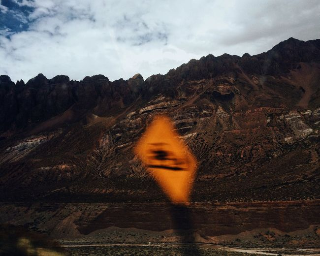 Blurred motion of road sign against mountains