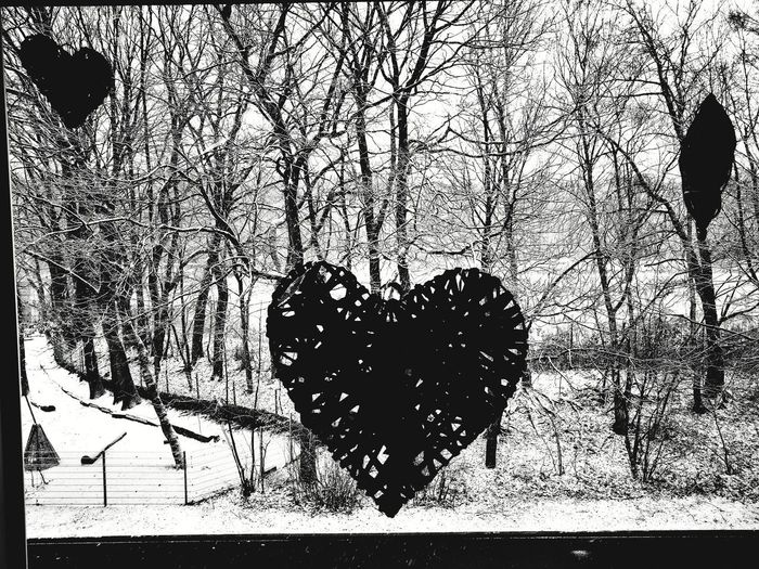 Digital composite image of heart shape on snow covered field