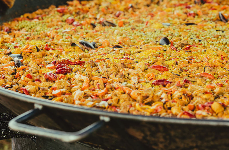 High angle view of a spanish paella being cooked in a paella dish