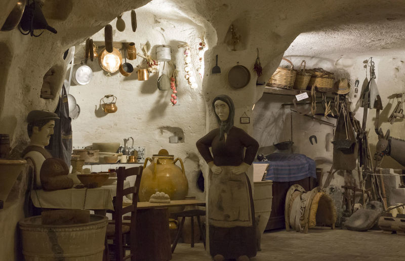 Matera Italy Unesco UNESCO World Heritage Site Grotto House Interior Ancient Cave Indoors  Choice Variation Container Seat Messy Large Group Of Objects Business Occupation Chair Illuminated People Group Of People Architecture Real People Table Store Lighting Equipment Small Business