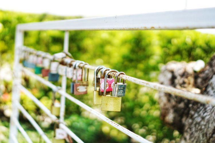 Old lock on iron rail. Padlock No People Consumerism Nature Hanging Lock Railing Love Lock Outdoors Day