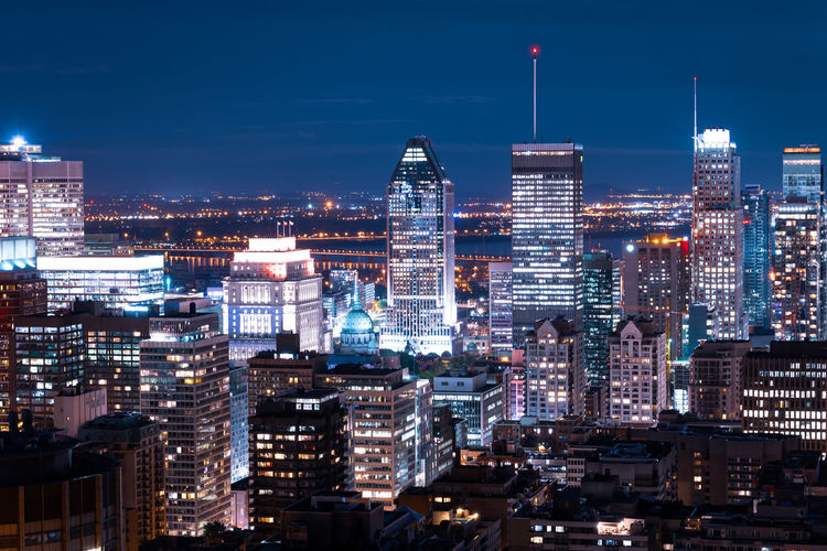 Building Exterior City Architecture Built Structure Cityscape Illuminated Office Building Exterior Building Skyscraper Night Modern Sky Landscape Tall - High Crowd City Life Office Tower Travel Destinations Crowded Financial District  Outdoors Nightlife Spire  Montreal, Canada Skyline City View  Night Life