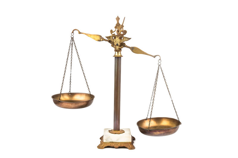Conceptual of lopsided scale - unfair and unjust Bias LIBRA Balanced Brass Close-up Equality Equilibrium Fairness Gold Colored Isolated On White Justice Justice - Concept Law Legal System Lopsided Mass - Unit Of Measurement No People Scales Studio Shot Weight Scale White Background