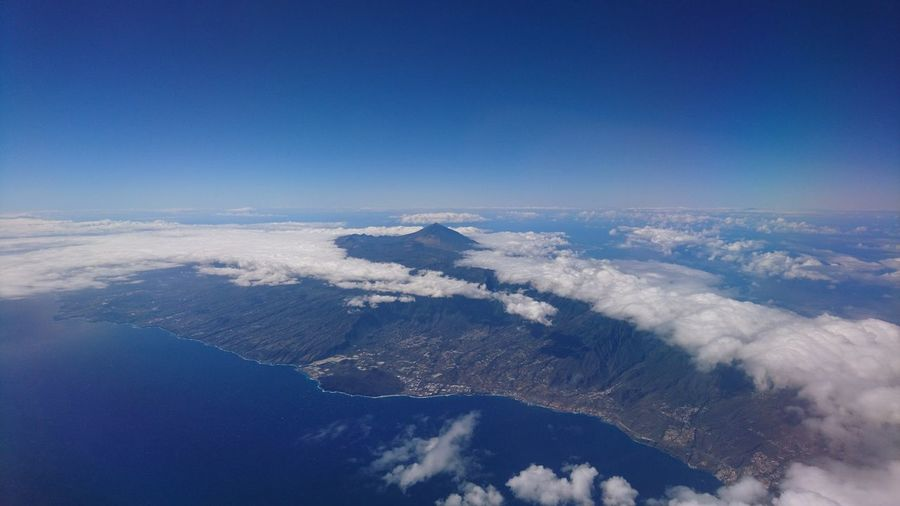 Tenerife and El Teide. Tenerife SPAIN España Canary Islands Islas Canarias Teide El Teide Volcano Aerial View Aerial From An Airplane Window Blue Clouds Clouds And Sky Island Island View  Beauty In Nature Nature Beauty Atlantic Ocean Atlantic Sea Water Blue Sky