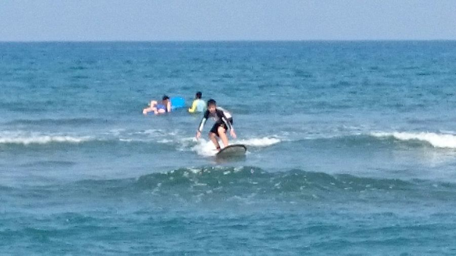 My son, Joshua Buenaventura, trying the waves of La Union.