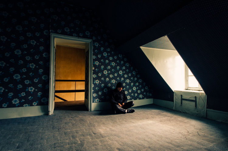 One Person Indoors  Sitting People Adults Only Adult Full Length Living Room Day One Man Only Man Real People Abandoned Urbex Homeless Alone Solitude Room Empty Only Men