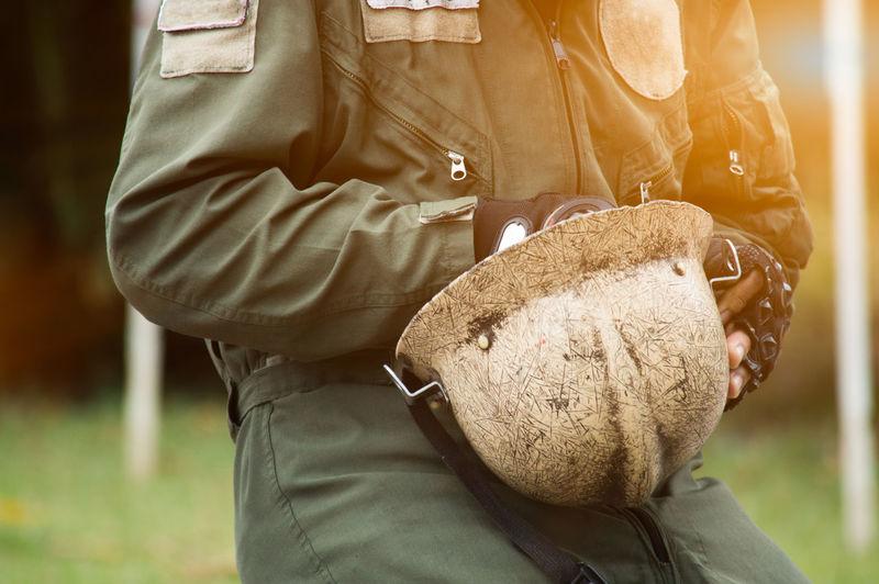 Firefighter Hat Danger Dangerous Fire Hand Holding Men One Person Outdoors Safty Security Uniform