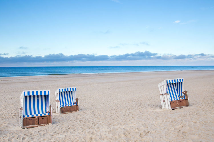 Chairs At The Beach Beach Beach Chairs Beauty In Nature Blue Blue Sky Blue Sky And Clouds Chair Coastline Horizon Over Water Landscape Nature Ocean Relaxation Sand Sea Simplicity Sky Summer Sunset Tourism Tranquil Scene Travel Travel Destinations Vacations Water