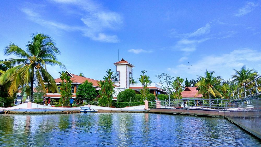 Water Swimming Pool No People Tree Outdoors Palm Tree Day Sky Nature Blue Architecture Landscape Relaxing Clouds And Sky Vacations Environment Kerala The Gods Own Country ;) Lakepalace Beauty In Nature