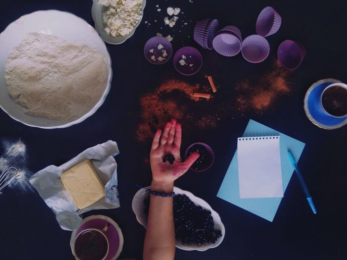 Human Hand Close-up Sweet Food Baking Child Cinnamon Roll  Muffins Cup Directly Above Baking Ingredients Flat Lay Pastel Purple Blueberries Forest Fruits Flour Black Currants Food Kids Baking