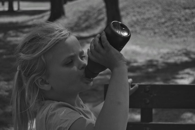 Girl Water Bottle  Thirsty  Thirst City Location City Life City Lifestyles Lifestyle Park Park - Man Made Space City Park Sunlight Urban Nature Child Childhood Girls Headshot Elementary Age Close-up Thoughtful Monochrome Pretty Caucasian #FREIHEITBERLIN The Photojournalist - 2018 EyeEm Awards The Street Photographer - 2018 EyeEm Awards The Portraitist - 2018 EyeEm Awards The Traveler - 2018 EyeEm Awards This Is Strength My Best Photo 17.62° The Art Of Street Photography Springtime Decadence