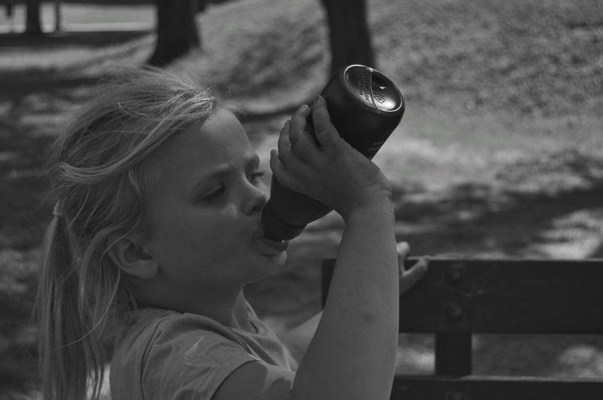 Girl Water Bottle  Thirsty  Thirst City Location City Life City Lifestyles Lifestyle Park Park - Man Made Space City Park Sunlight Urban Nature Child Childhood Girls Headshot Elementary Age Close-up Thoughtful Monochrome Pretty Caucasian #FREIHEITBERLIN The Photojournalist - 2018 EyeEm Awards The Street Photographer - 2018 EyeEm Awards The Portraitist - 2018 EyeEm Awards The Traveler - 2018 EyeEm Awards