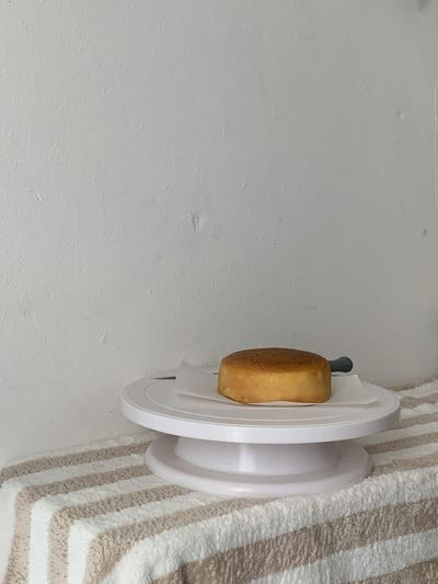 Close-up of breakfast served on table against wall