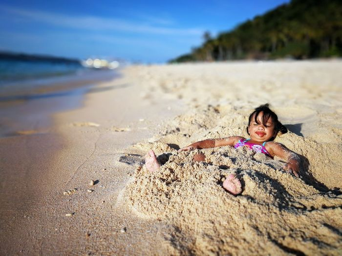 Baby Girl In The Sand Baby In The Beach Beach Boracay Island  Family Leisure Activity Lying Down Nature Outdoors Puka Beach Sand Shore Vacations Water