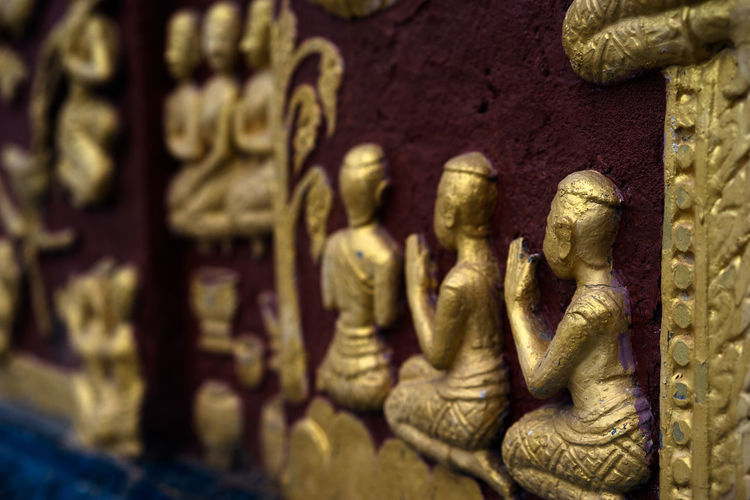 Luang Prabang, Laos Wat Xieng Thong Buddhism Buddhist Monks Buddhist Temple Close-up Golden Buddhas Laos Laos Buddhism Luang Prabang Religion Sculpture Small Buddhism Temple Small Golden Buddhas Spirituality Street Scene Temple Life Wat Life