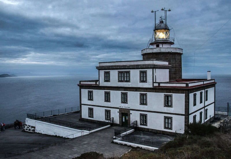 """Lighthouse of Cape Finisterre (""""end of the earth""""), Galicia, Spain Architecture Beauty In Nature Building Exterior Built Structure Cliff Cloud - Sky Cloudy Day Endlessness Finistere Galicia Horizon Over Water Lighthouse Lighthouse Miles Away Nature No People Ocean Outdoors Scenics Sea Sky SPAIN Tranquility Water Miles Away Secret Spaces Neighborhood Map The Architect - 2017 EyeEm Awards Your Ticket To Europe Go Higher"""