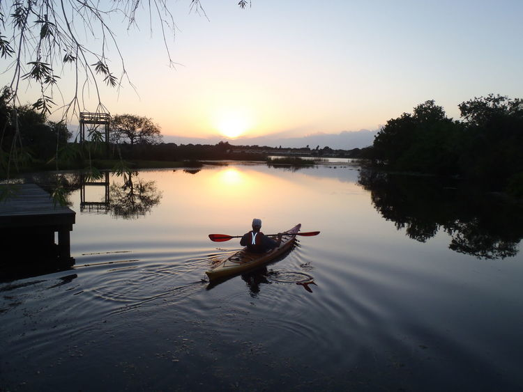 Kayaking Sunset Kayaker Kayak Solitary Man Solitary Traveler Kayaks Into The Sunset Sunrise And Sunsets Sunrise Silhouette Sunset Silhouettes Twillight Hour Twillight Waterscape Landscapes This Is Aging