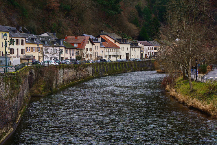 River amidst houses and buildings in town