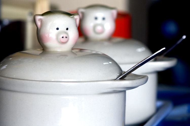 Pig shaped lids on porcelain containers