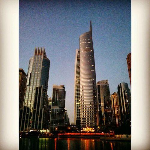 На клупа во маало Dubai JLT Lakes  Viewfrommybench neighbourhood lights glass chrome architecture skyscrapers sunset stroll