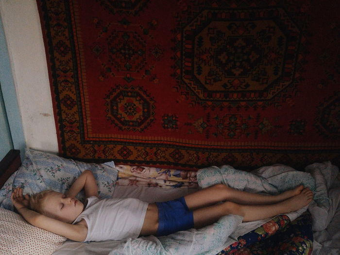 Little boy's sweet dream. Real People Authentic Candid Conceptual Realism Second Renaissance Boy Little Kid Childhood Dreem Retro Sleeping This Is Family Lying Down Sleeping Bed Bedroom Carpet Pillow Waking Up Carpet - Decor Cozy